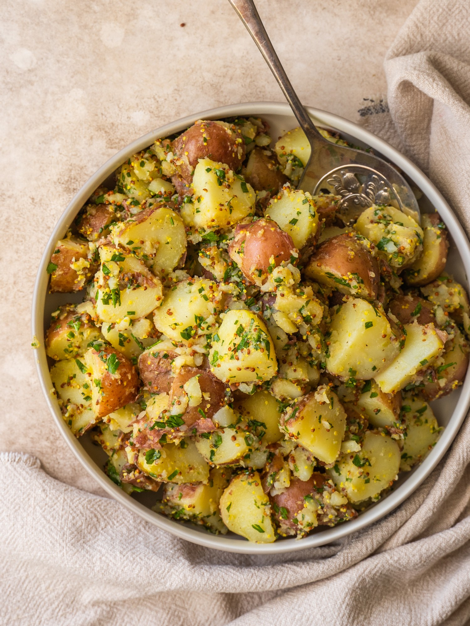 Above view of herbed potato salad in a serving bowl