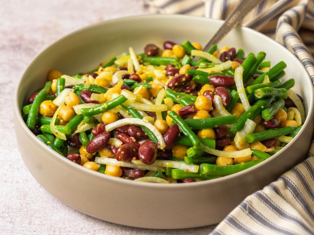 Three quarter view of three bean salad recipe made with a honey mustard salad dressing