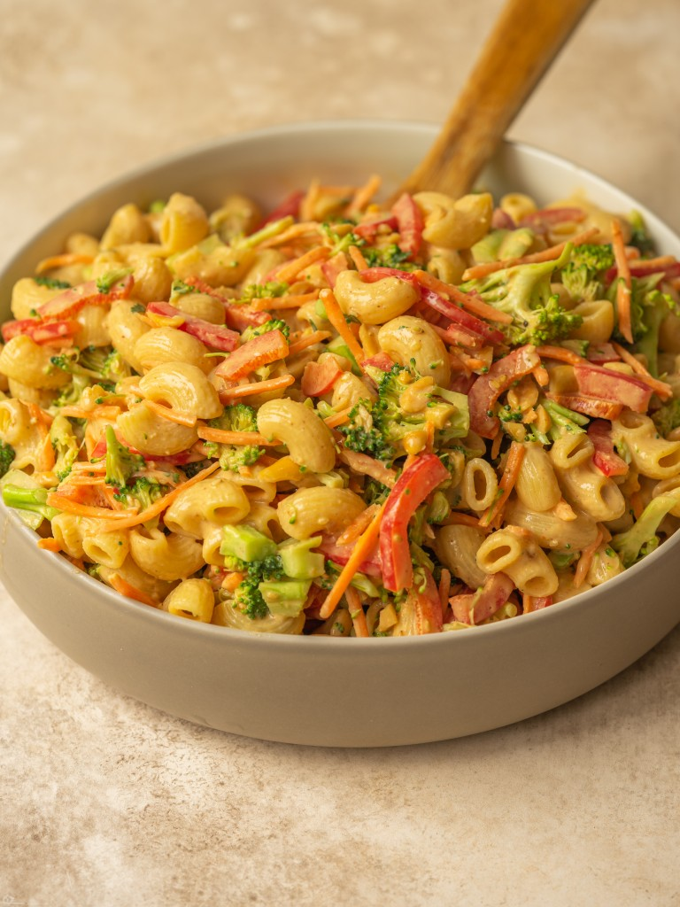 Three quarter view of vegan pasta salad made with veggies and a peanut salad dressing