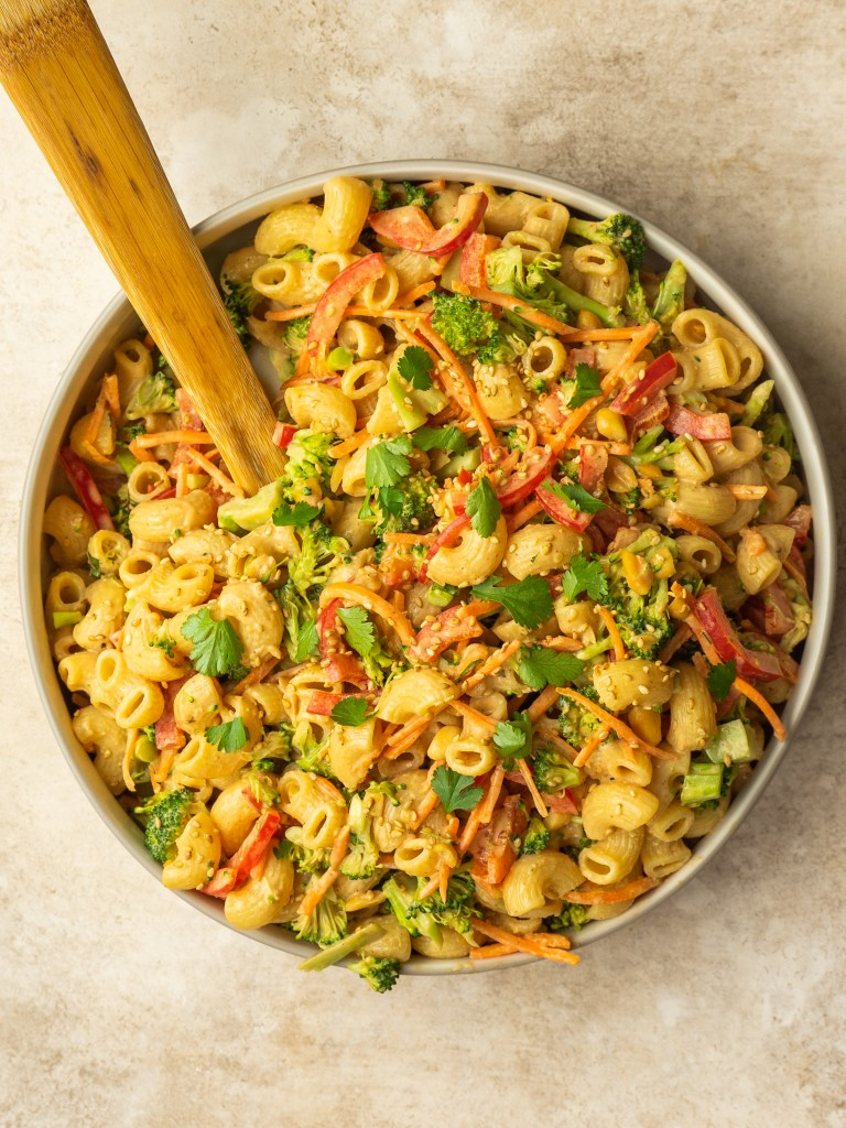Above view of a broccoli pasta salad made with a peanut dressing