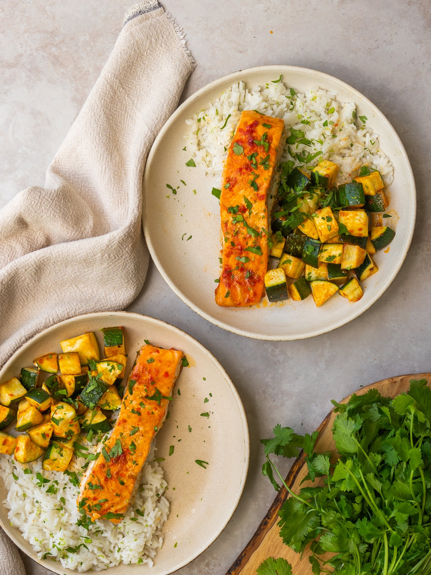 Above view of sheet pan harissa salmon in serving bowls with rice