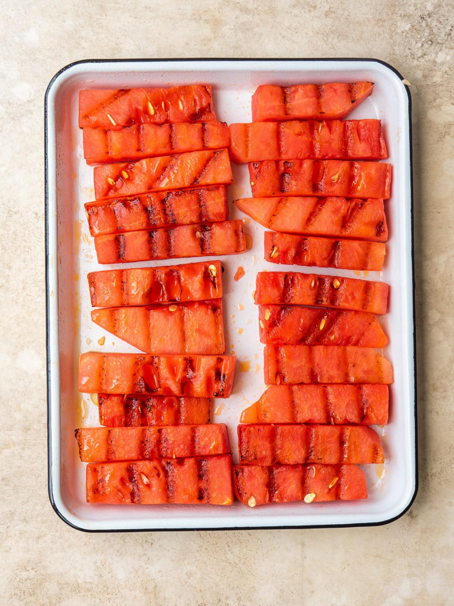 BBQ watermelon sticks on a sheet pan