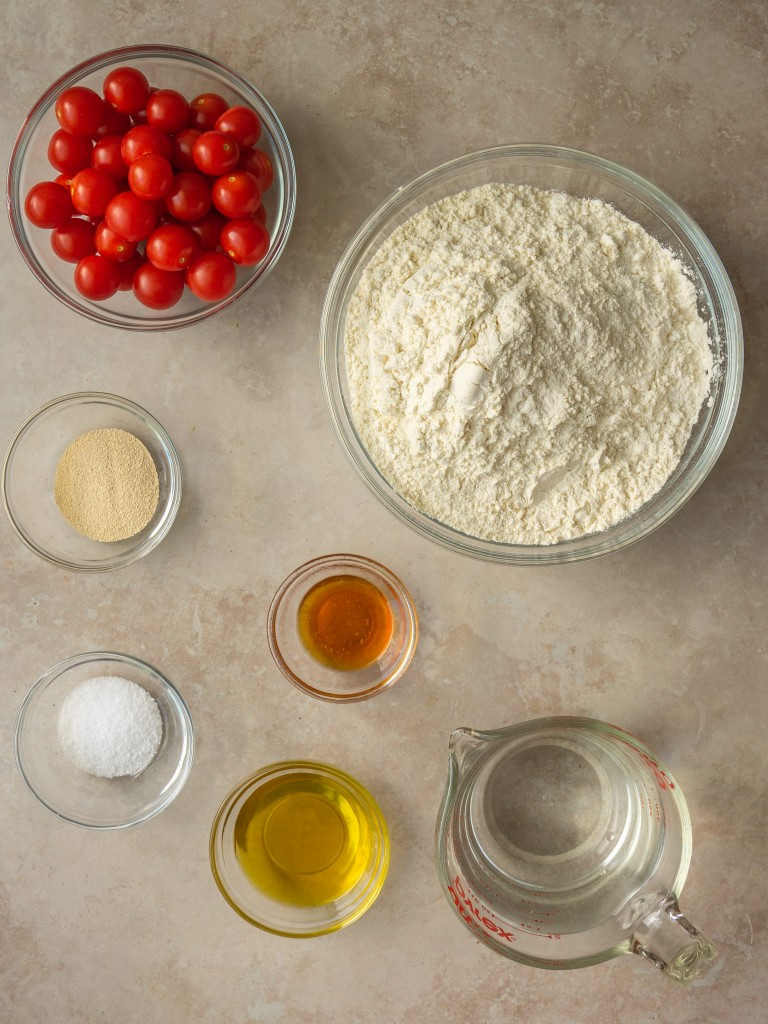 Above view of ingredients for tomato focaccia