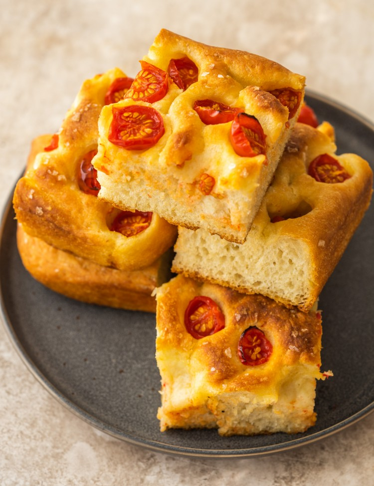 Above view of no knead tomato focaccia on a plate