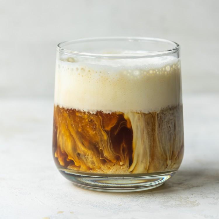 Side view of honey vanilla iced shaken espresso