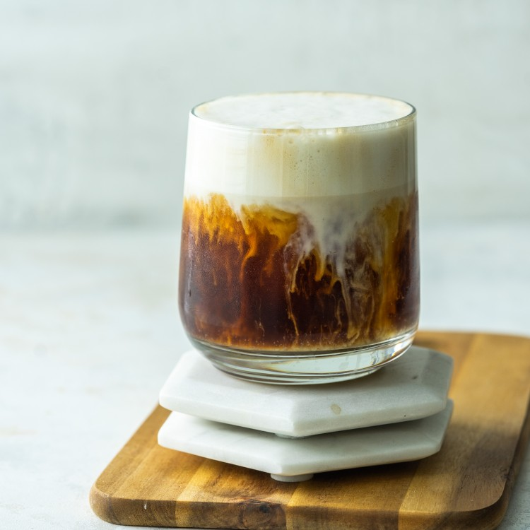 Side view of an iced brown sugar oat milk shaken espresso