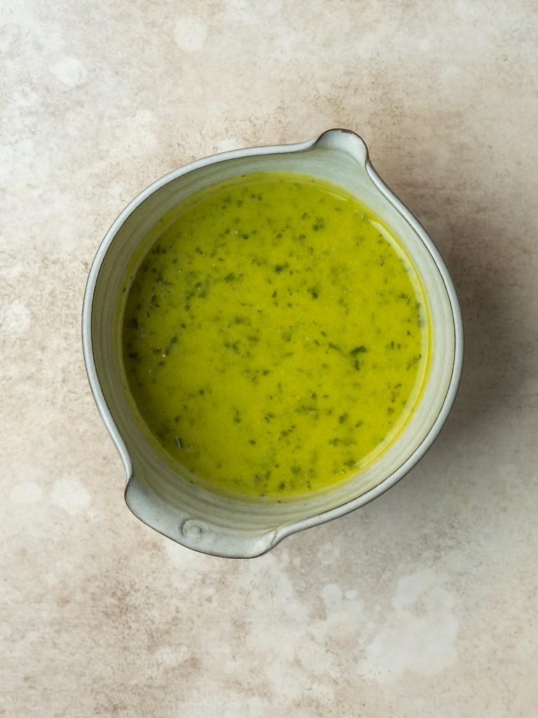 Lemon basil vinaigrette in a serving bowl
