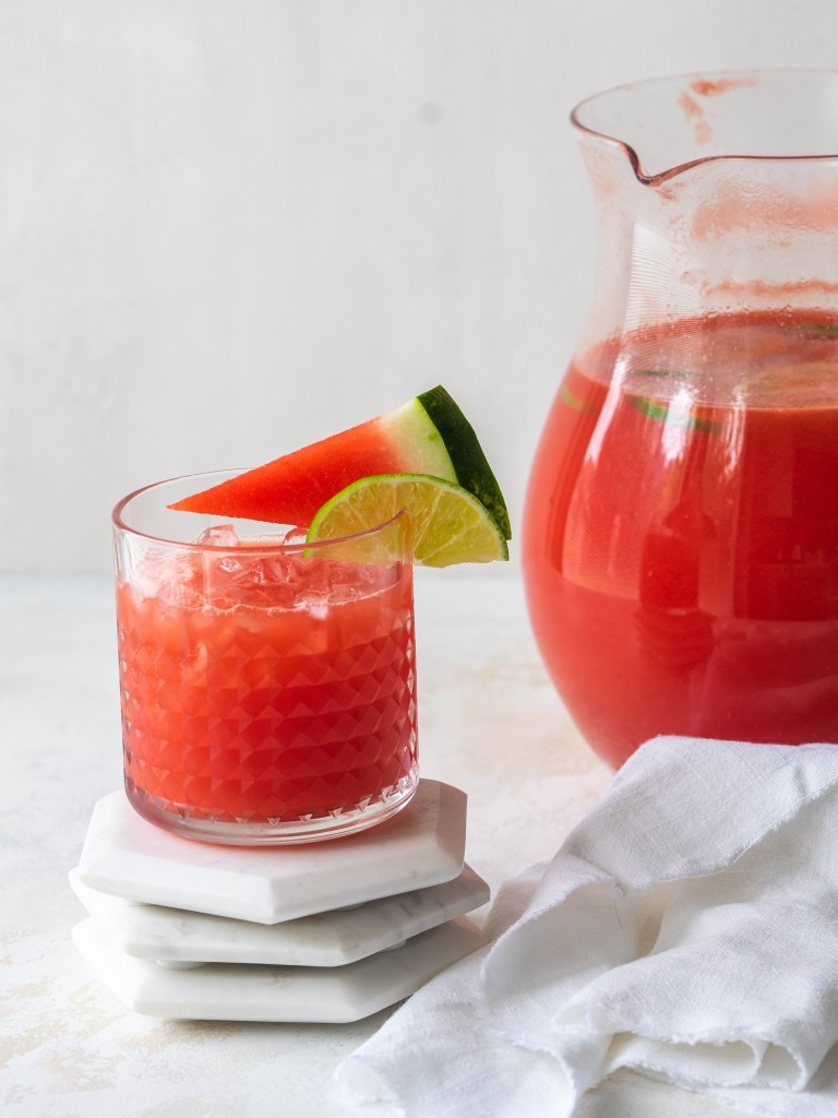 Side view of a watermelon drink in a cocktail glass