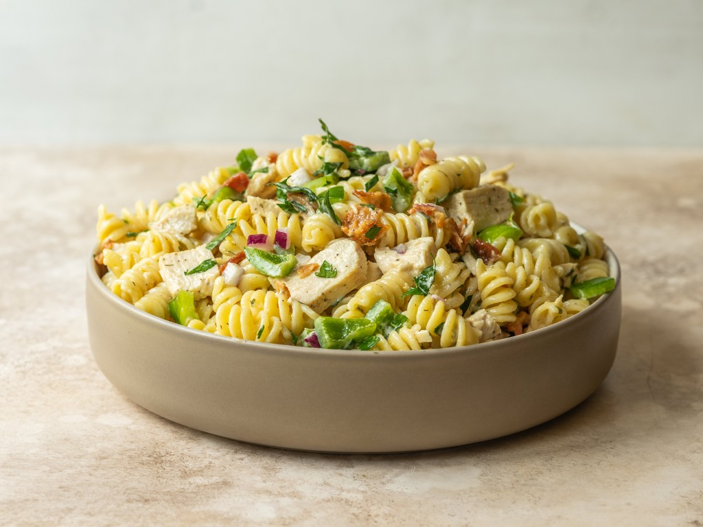 Side view of a chicken bacon ranch pasta in a serving bowl