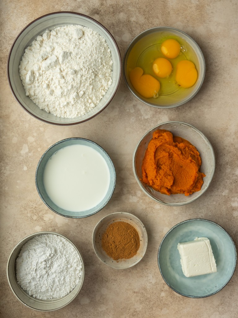 Above view of ingredients for a pumpkin and yellow cake mix recipe