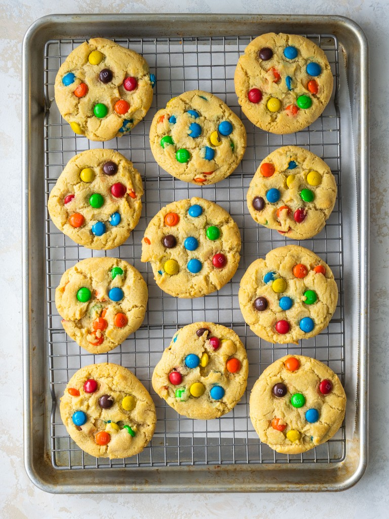 Baked sugar cookies with m&ms on a wire cooling rack