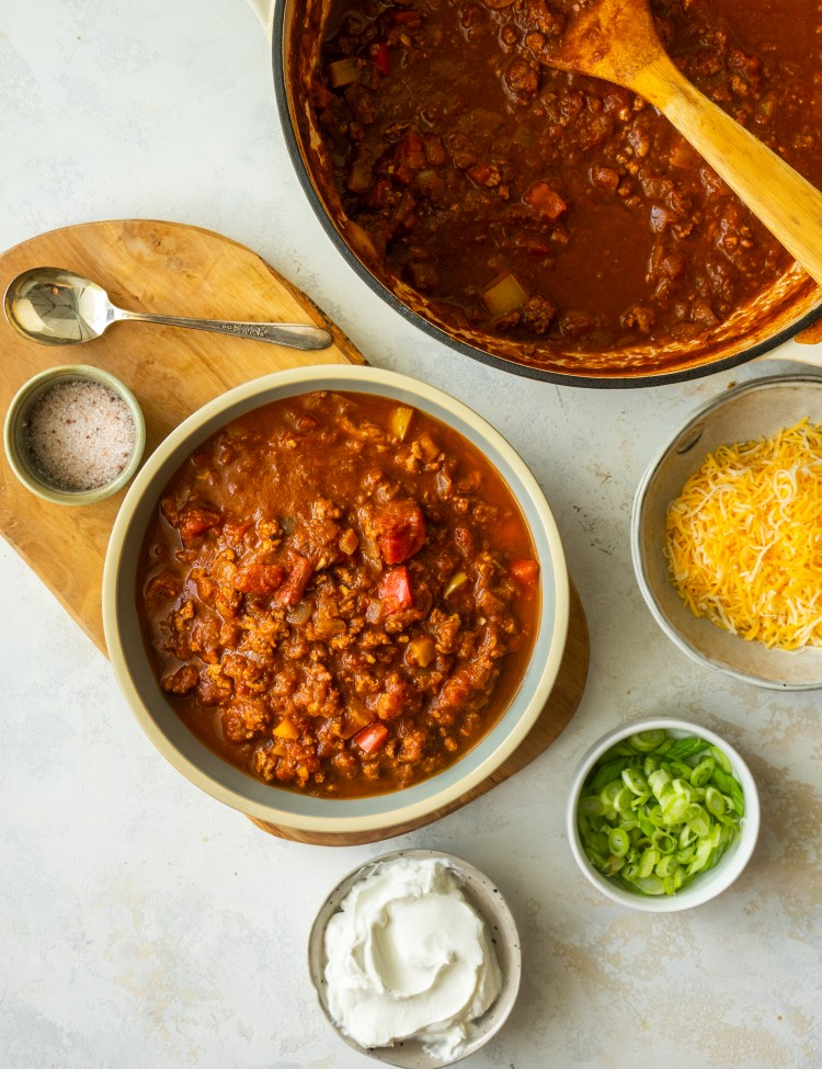 No bean turkey chili recipe in a serving bowl next to topping options