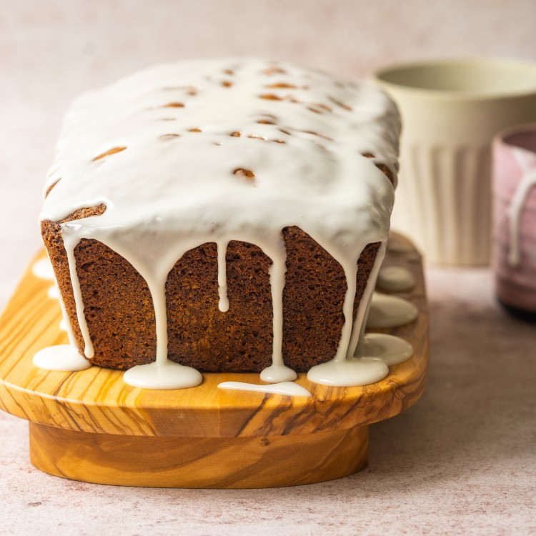 Side view of a spice cake with icing on top